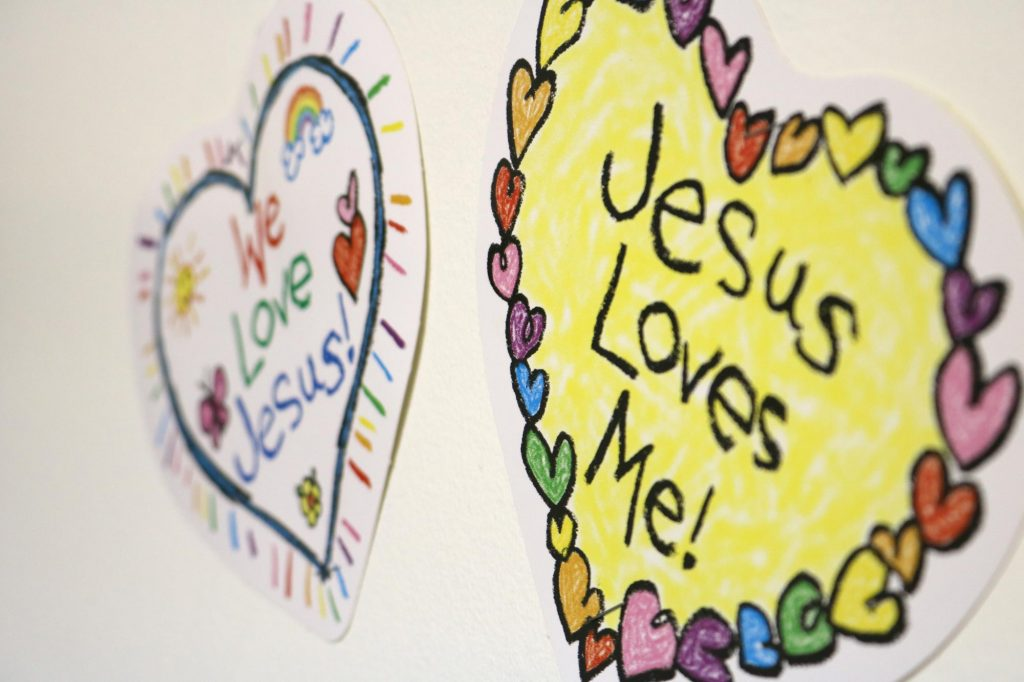"""Signs that read, """"We love Jesus,"""" and """"Jesus loves me,"""" in a Sunday school classroom at Holy Trinity Catholic Church"""