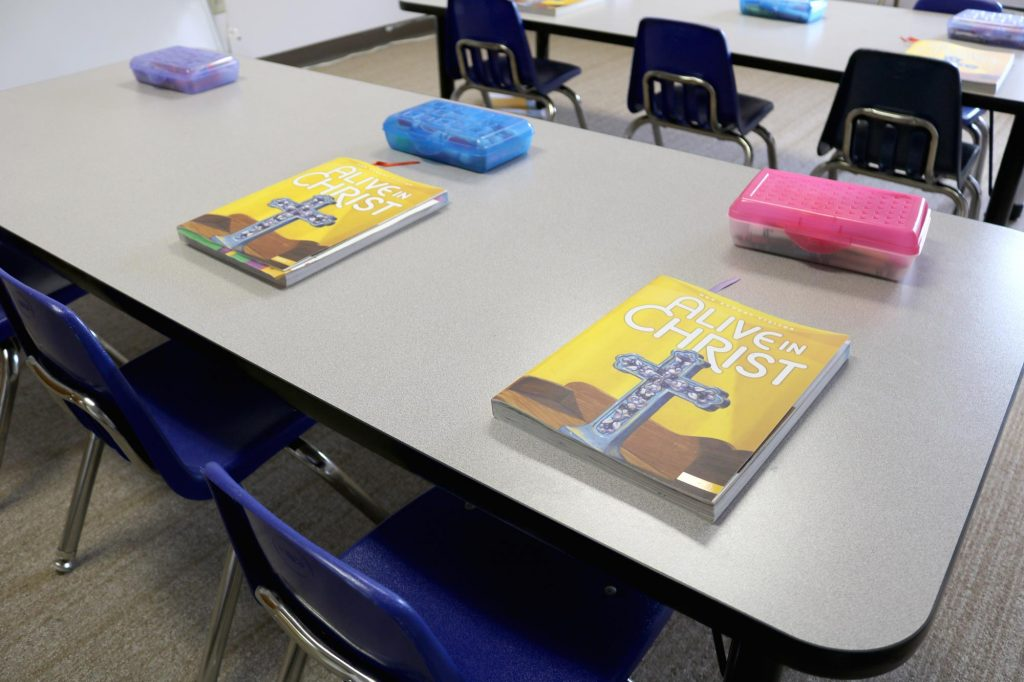 Sunday school PSR classroom with chairs, desks, and books at Holy Trinity Catholic Church