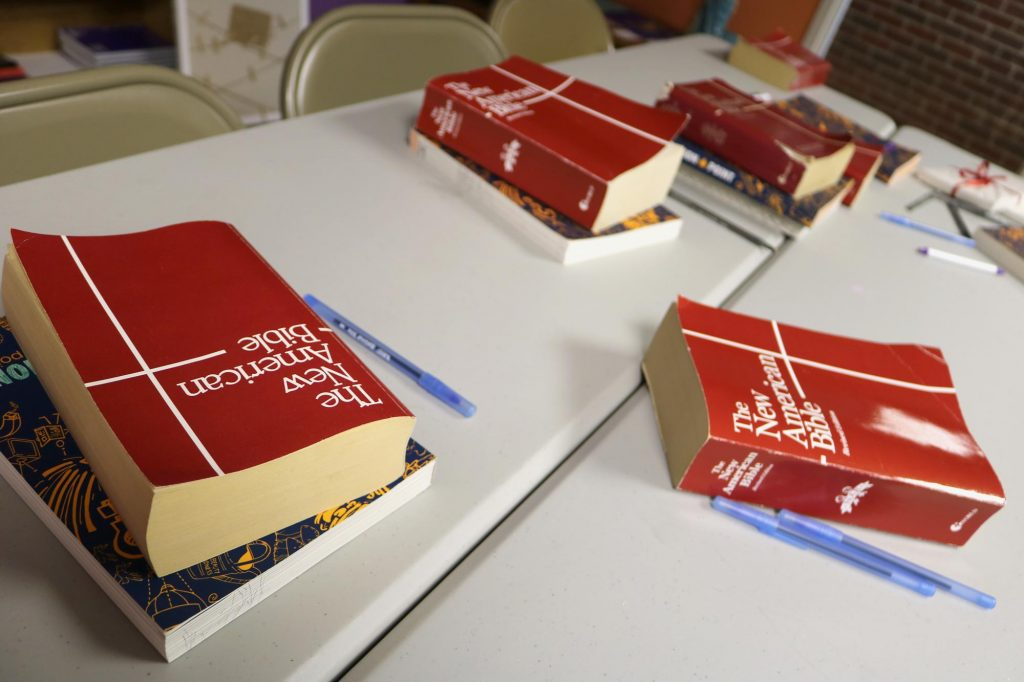 A table with Bibles at Holy Trinity Catholic Church