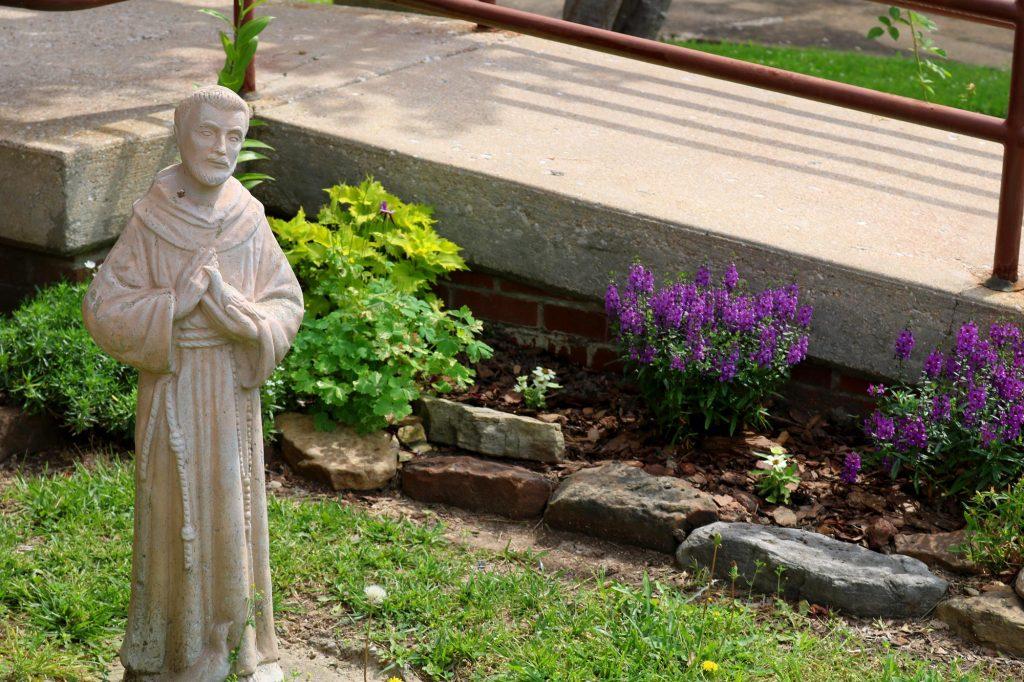 St Francis statue outside of Holy Trinity Catholic Church